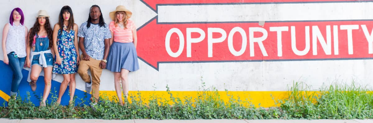 students stand in front of a career opportunity sign in tulsa ok