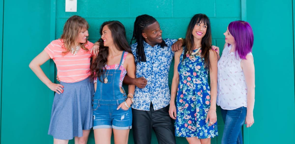 5 students pose in front of a teal wall at clary sage college in tulsa ok